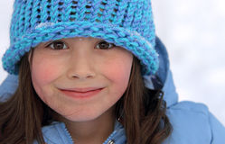 Happy girl with woolly hat Royalty Free Stock Images