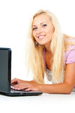 Happy girl with a laptop Stock Photography