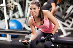 Happy girl working out in a gym Royalty Free Stock Photos
