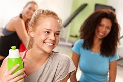 Happy girl after workout at the gym Royalty Free Stock Photos
