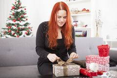 Happy girl wrap christmas present boxes Royalty Free Stock Photo