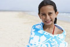 Happy Girl Wrapped In Towel Standing At Beach Stock Images