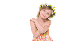 Happy girl with wreath of daisies stock photo