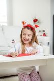 Happy Girl Writing Letter To Santa Claus Royalty Free Stock Photos