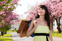 Happy girl in a yellow dress walking down the aven Stock Photography