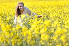 Happy girl in yellow flowers Stock Photo