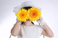 Happy girl with yellow flowers Royalty Free Stock Photography