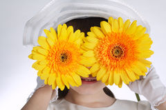 Happy girl with yellow flowers Royalty Free Stock Photo