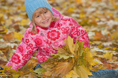 Happy girl with yellow leaves Royalty Free Stock Photos