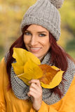 Happy girl with yellow leaves Royalty Free Stock Photo