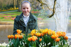 Happy girl with yellow tulips. Stock Photography
