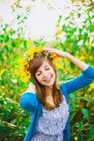Happy girl and yellow wreath Stock Image