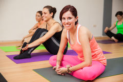 Happy girl in yoga class Royalty Free Stock Photos