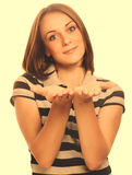 Happy girl young portrait woman showing open hand holding isolat Stock Photography