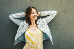 Happy girl, Young woman holding hands behind head and smiling royalty free stock photo