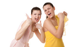 Happy girlfriend. Two girls show a victory gesture Stock Image