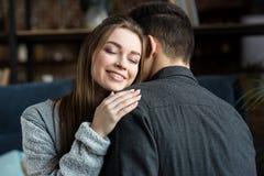 Happy girlfriend hugging boyfriend. With closed eyes stock photos