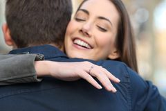 Happy girlfriend after marriage proposal stock photography
