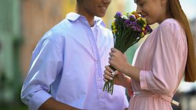 Happy girlfriend receiving bouquet of beautiful flowers from her boyfriend, love. Stock footage stock footage