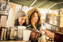 Happy girlfriends best friends having fun at coffee vendor stock image