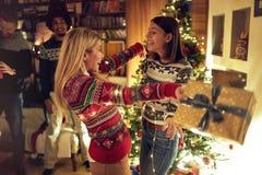 Happy girlfriends celebrating Christmas stock photography