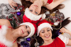Happy girlfriends with  Christmas decoration. Royalty Free Stock Photos