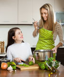 Happy girlfriends cooking  together Stock Images