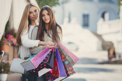 Happy girlfriends go shopping at the mall Stock Photo
