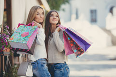 Happy Girlfriends Go Shopping At The Mall Stock Photos