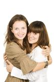 Happy girlfriends hugging Royalty Free Stock Images