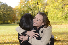 Happy girlfriends hugging Stock Photos
