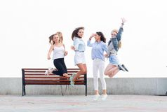 Happy girlfriends jump up, laugh and rejoice royalty free stock photos