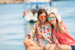 Happy girlfriends near the sea royalty free stock photography