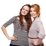 Happy girlfriends standing embraced and smiling Royalty Free Stock Photos