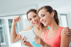 Free Happy Girlfriends Using A Tablet Stock Photo - 58649090