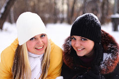 Happy girls. Two happy, young girls smile and look in the camera Stock Photo
