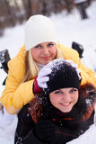 Happy girls. Two happy, young girls play with each other outdoors Royalty Free Stock Photography
