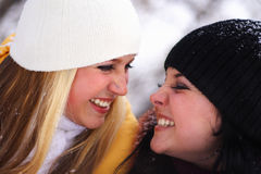 Happy girls. Two happy, young girls smile and look against each other Royalty Free Stock Photos