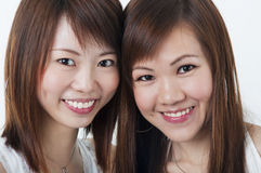 Happy girls. Close up cheerful Asian girls royalty free stock images