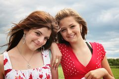 Happy girls. Complicity between two beautiful teenager stock photography