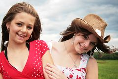 Happy girls. Complicity between two beautiful teenager stock images