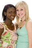 Happy Girls. Two smiling attractive young women on white background Royalty Free Stock Photos