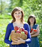 Happy girls with apples harvest Stock Photo