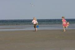 Happy girls on beach stock photo