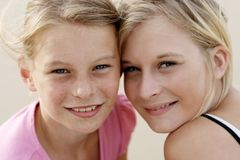 Happy girls on the beach Stock Image