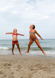 Happy girls on the beach stock images