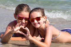Happy girls on the beach Royalty Free Stock Photo