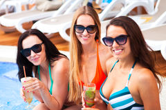 Happy girls with beverages on summer party near the pool, summer royalty free stock images