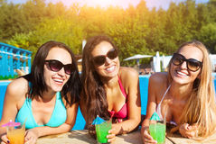 Happy girls with beverages on summer party Royalty Free Stock Image
