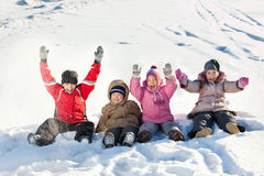 Happy girls and boys in winter Royalty Free Stock Photo
